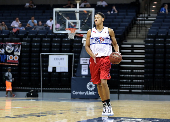 CHARLOTTESVILLE, VA - JUNE 18: Ben Simmons #75 in white brings the ball up the court during the National Basketball Players Association Top 100 Camp on June 18, 2014 at John Paul Jones Arena in Charlottesville, Virginia. (Photo by Kelly Kline/Getty Images)