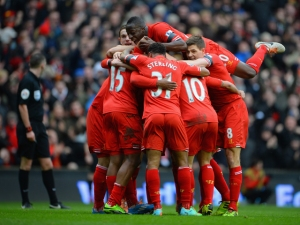 LIVERPOOL, ENGLAND - FEBRUARY 08: Daniel Sturridge of Liverpool celebrates with his team-mates after scoring the fourth goal during the Barclays Premier League match between Liverpool and Arsenal at Anfield on February 8, 2014 in Liverpool, England. (Photo by Michael Regan/Getty Images)